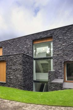 1000 images about stone wall on pinterest stone walls for Exterior stone wall house design