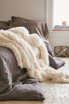 A faux lamb fur throw that'll make you feel like you live at Winterfell.   21 Things That Will Make Your Bedroom Even Cozier