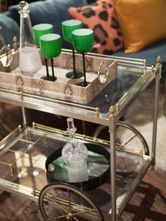 Jessie Miller's bar cart setup, featuring her vignette's signature hue: emerald green. (http://www.hgtv.com/hgtv-star/hgtv-star-photo-highlights-from-episode-1/pictures/page-40.html?soc=Pinterest)