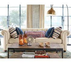 No pull out option available. Grand size sofa will work. Chesterfield Upholstered Sofa #potterybarn