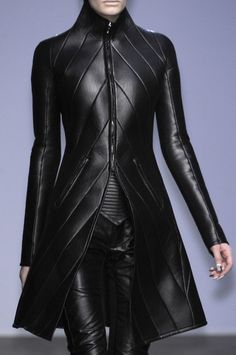 Black leather coat with angled strips -- Gareth Pugh