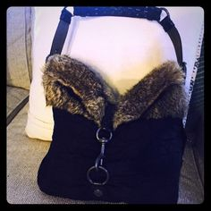 COACH HANDBAG Coach handbag with real fur. Black with coach embellishments. Dark grey hardware with buttons down the side. Perfect condition. Used handful of times. No marks. Coach Bags Shoulder Bags