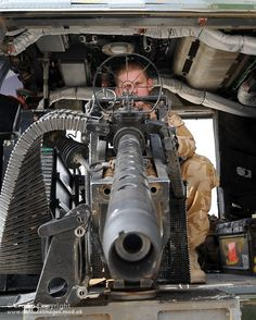 An Army Air Corps Door Gunner onboard a Lynx helicopter with 672 Squadron in Afghanistan, is pictured looking through the sights of a Heavy Machine Gun (HMG). Military Helicopter, Military Weapons, Weapons Guns, Guns And Ammo, Military Aircraft, Heavy Machine Gun, War Machine, Big Guns, Cool Guns
