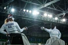 Brazil's Suelen Rodolpho (R) competes with Belarus's Alesia Makrytskaya during the women's epee team placement 5-6 match in the Paralympic Games at the Olympic Park in Rio de Janeiro on September 15, 2016. / AFP / YASUYOSHI CHIBA