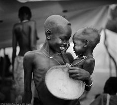 A rare moment of joy between siblings at the Ajiep feeding centre in southern Sudan in 1998