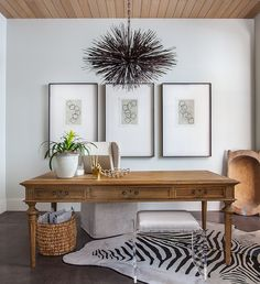 Chic office features a wood plank ceiling accented with a Troy Lighting Uni Large Pendant hanging ...