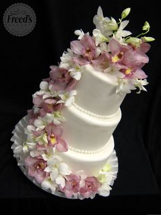 Simple, three tier cake with orchid cascade. Do a small decorated cake on a pedestal, and have a sheet cake in the kitchen for cutting and serving. Wedding Cake Fresh Flowers, Floral Wedding, Gorgeous Cakes, Pretty Cakes, Cupcakes, Cupcake Cakes, Amazing Wedding Cakes, Sugar Flowers, Real Flowers