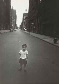"""Robert Frank, """"On Saturday and Sunday the street is empty. Georgie is alone."""", from  People You Don't See, 1951"""