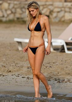 Soaking up the sun: Ashley James headed straight for the sun-soaked shoreline of Ibiza after she jetted to the island for some R&R, changing into a tiny bikini