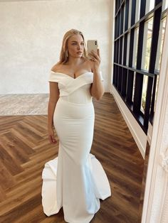 The gorgeous Lottie V2 is made of an amazing french crepe, and features the most divine off the shoulder neckline. Her fitted skirt will hug your curves. #mwllottiev2 #madewithlovebridal #nzwedding #nzbride #felicitysbridalnz French Crepes, Fitted Skirt, Hug You, Off The Shoulder, Curves, Neckline, Bridal, Wedding Dresses, Skirts