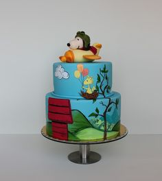 Flying Snoopy Birthday Cake!! I would need to practice a TON before I could actually do this but this looks awesome!!... Unless I get some paint brushes and a toy snoopy! That'd make it much easier!!