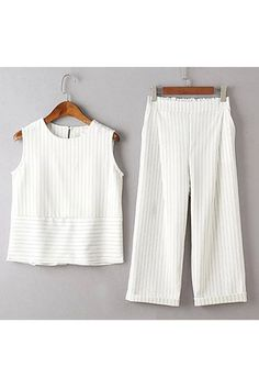 Cut from a stripe printed, this set features a sleeveless crop top with a round neck and one button back closure, as well as rolled ankle cuffs trousers that boast side pockets and a elastic waistband. Wear this set with loafers for a sharp gamine vibe, or dress it up with strappy heels for a look that any style seeker would envy.