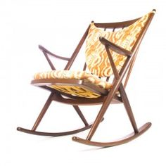Vintage rocking chair by Frank Reenskaug for Bramin. This elegant fiftees rocking chair (model 182) with the typical shaped pillows  is in superb condition with minimal userwear. Marked with the Bramin label.  http://www.retrorevolution.nl/furniture/189-bramin-rocking-chair.html