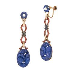 Art Deco Carved Lapis Lazuli Enamel Pendant Earrings. Carved floral motif lapis lazuli plaques are suspended on figure 8 red and black enamel links with carved lapis and pearl tops mounted in 14 karat yellow gold.