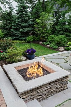 Rustic Landscape/Yard with Raised beds, FireScapes Smooth Ledge Square Natural Gas Fire Pit, exterior stone floors, Fire pit