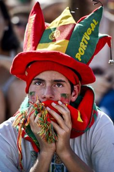 FIFA World Cup 2014  A fan of the Portugal national football team watches in Eduardo VII Park in Lisbon on June 16, 2014 the FIFA World Cup 2014 match Germany vs Portugal played in Salvador, Brazil