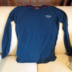 Nike Dri-Fit Gyakusou Running Shirt Never worn Nike Dri-Fit Gyakusou International Running Association by Undercover Lab two toned running shirt; right side zip pocket to hold valuables while you are out on a run. Waterproof, breathable fabric. Nike Tops Tees - Long Sleeve