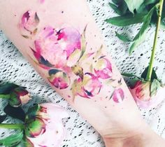 Watercolor style tattoo art of motive Flowers by artist Pissaro Tattoo