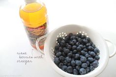 Rinse your berries in vinegar (both white and apple cider will work)