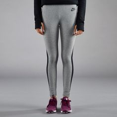 Nike Heathered Grey Leggings The Nike Heathered leggings are made with a soft, strechty cotton blend for comfortable coverage wherever you go. Side insets wrap around your leg for a range of motion and style.   Women's size small.   NEW with tags. Nike Pants Leggings