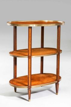 A good Regency period burr amboyna Etagère of fine colour and patina, the edges broadly cross banded, the uprights with reserved amboyna panels. 99.06 cm high  83.82 cm wide  50.80 cm deep