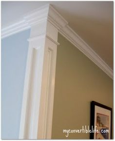 Add a column effect at the corners of the room, which is open to the kitchen on one end and the foyer/hall on the other end. separate the room (and the wall colors) without taking up any real space in the floor plan.