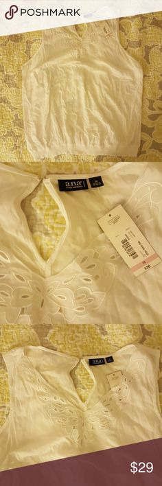 NWT Beautiful White Top Light white top perfect for these upcoming warmer months! Stretch band around bottom of the top. Key hole opening in back. New with tags! a.n.a Tops