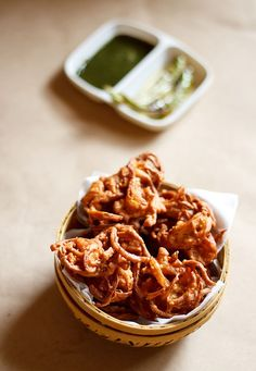 onion pakoras recipe with step by step photos and video - onion fritters made with gram flour are a popular indian street food. it is one snack that is easy to prepare and tastes good too.    onion pakoras are usually