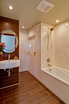 Like the wood plank tile floor - adds a warm touch to bathroom