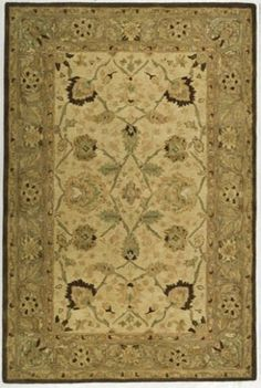 This is not handmade--just a tufted rug (under 2K)