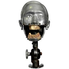 Early Dental Teaching Machine - 1930-1950  A striking dental mannequin. The removable teeth look to be celluloid and show cutaway areas for students. This example has the complete mounting mechanism and can be clamped to a desk or shelf as is.