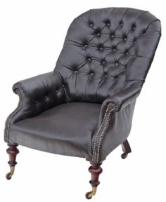 Antique 19C Victorian button back soft dark brown leather armchair. Quality, attractive chair, with no loose joints or wobbles. Lovely legs with brass and ceramic castors. Great proportions and styling, which would look amazing in the right location. The seat upholstery is recent, with only light wear and minor marks. Overall maximum dimensions: 73cmW x 102mmD x 91cmH (36cmH seat when sat on).