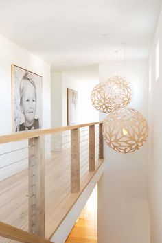 Simple decorative pendant lights hang above the stairs, while a simple wood and wire cable handrail continues with the farmhouse look. innenarchitektur holz A Contemporary House In California Was Designed With Farmhouse Elements Throughout Decor, House Design, Country Modern Home, Farmhouse Design, House Styles, Home Decor, Contemporary House, David Trubridge Lights, Rustic House