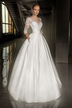 Sweet heart wedding gown with hand beaded beautiful lace sleeves. Full satin skirt is simple, yet very elegant. Pleated waist is very slimming.