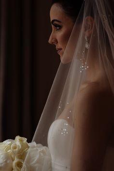 Bride with white bouquet and veil. Claridges Wedding London. #weddingphotography #claridgeswedding