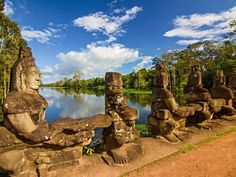 Angkor water and statues- 100 trips everyone should take in their lifetime