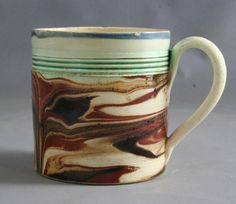 Small creamware mug decorated with marbelised slip, circa 1810