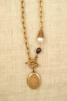 One-of-a-kind necklace with antique locket and freshwater pearls by ExVoto Vintage Jewelry.
