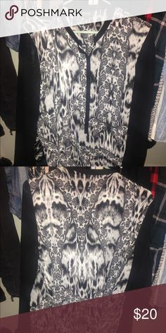 Nicole by nicole miller printed buttonup Black and white patterned buttoned up blouse with a wrapped detail that crosses over in the back of of the top Nicole by Nicole Miller Tops Button Down Shirts