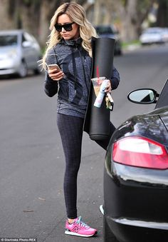 ...and still checking the phone: The Phineas And Ferb star, who produces ABC's Young & Hungry, stopped by her car as she carried on reading