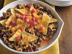 Nacho skillet casserole: Start with classic nacho ingredients and blend them with ground beef and easy canned corn and peppers for a quick skillet supper. Indian Corn Recipes, Mexican Food Recipes, Beef Recipes, Dinner Recipes, Cooking Recipes, Ethnic Recipes, Beef Meals, Dinner Ideas, Recipies