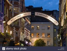 Illuminated arching sign welcoming visitors to the Carnaby Street, Soho, City of Westminster, London, England, United Kingdom