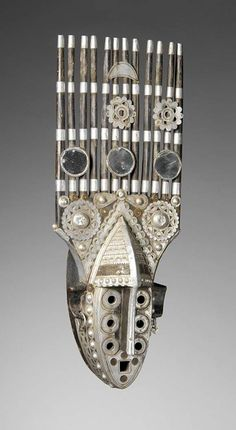 Africa | A Malinke mask that is usually found in the regions of Hamanah and G'bérédu (around Kouroussa, Kankan and Baro) in Guinea | 20th century | wood, aluminium, brass and mirrors