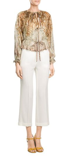 Etro's+weightless+silk+blouse+is+made+contemporary+and+striking+with+a+flower-scattered+print+in+brunt+toffee+coloring.+Ties+through+the+front+make+it+a+carefree+and+bohemian+style+#Stylebop