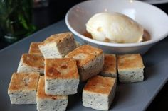 poppy and Parmesan biscuits served with honey drizzled clotted butter.  At The Tripel in Playa Del Rey, CA.