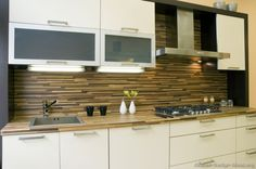 #Kitchen Idea of the Day: Modern white kitchen with horizontal tile backsplash.