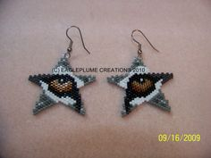 Star Earrings with wolf eye by EagleplumeCreations on Etsy, $18.99