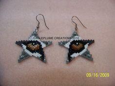 Star Earrings with wolf eye by EagleplumeCreations on Etsy, $18.99
