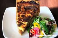 Dallas Foodies - Dallas Restaurants - Boulevardier - Quiche made with house bacon.spinach caramelized onion plus gruyere Parmesan arugula chicory salad!