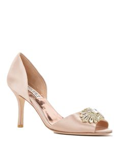 Jazmin Embellished Satin D'orsay Heel - Style # : JAZMIN - LATTE - $225.00 - SALE $149.00 - Jazmin by Badgley Mischka. Jazmin is a stunning shoe with a d'orsay heel. The heel height is at a very manageable level making it perfect for any event. It features a dazzling sun inspired brooch at the toe. - Heel height: 3 1/4 inches. - Sale price is only applicable to online purchases and not valid in Badgley Mischka stores. Items purchased on BadgleyMischka.com cannot be returned to Badgley…